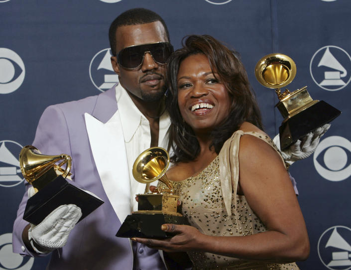 """FILE - In this Feb. 8, 2006, file photo, Kanye West and his mother, Donda, hold his three awards backstage at the 48th Annual Grammy Awards in Los Angeles. West won for best rap album, solo and song. Kanye West unveiled his 10th studio album, """"Donda,"""" in front of a packed crowd in Atlanta. His album was named after his mother, who died at the age of 58 following plastic surgery complications in 2007. (AP Photo/Reed Saxon, File)"""