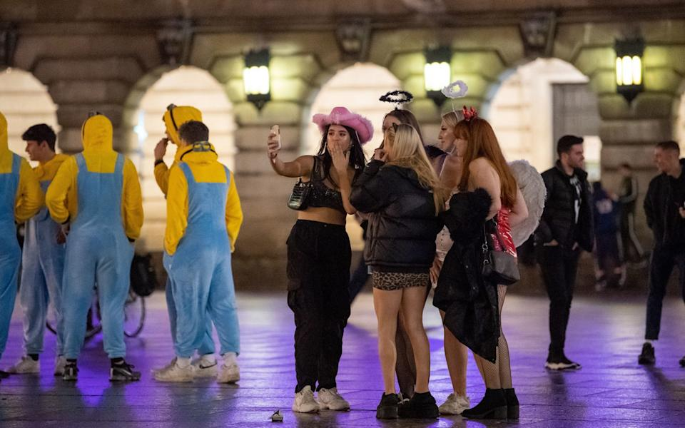 People in fancy dress in Nottingham after pubs and bars close - PA