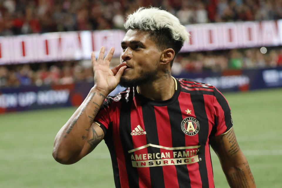 FILE - Atlanta United forward Josef Martinez (7) gestures towards the crowd after scoring a goal in second half of an MLS Eastern Conference Semifinal playoff soccer match against the Philadelphia Union in Atlanta, in this Thursday, Oct. 24, 2019, file photo. Martinez was knocked out of last year's season opener with an ACL injury that required surgeries that kept him out the rest of the season. He's not quite at full strength heading into United's opener, but close. (AP Photo/John Bazemore, FIle)
