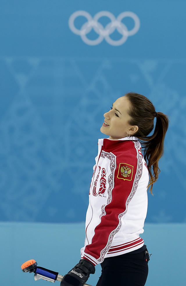 Russia's Anna Sidorova smiles after delivering the rock during the women's curling competition against China at the 2014 Winter Olympics, Tuesday, Feb. 11, 2014, in Sochi, Russia. (AP Photo/Wong Maye-E)