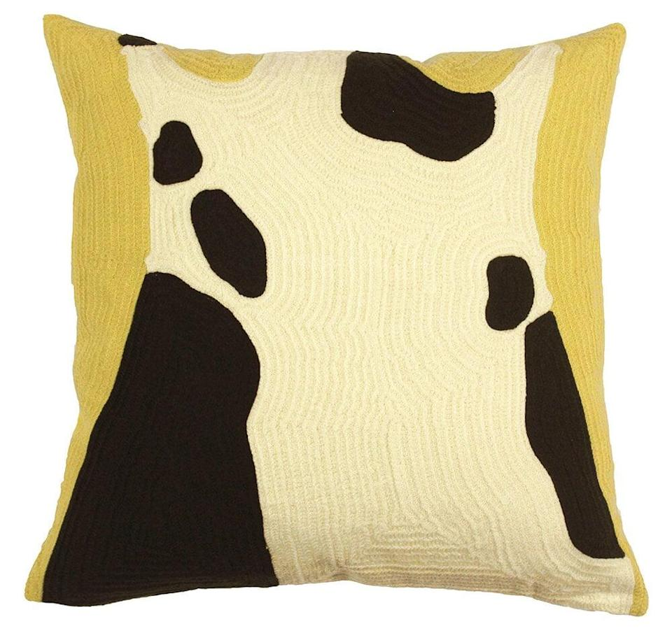 <p>We try to frequent local businesses whenever we can, so I jumped at the chance to add the cool<span>Cow Pillow</span> ($65) from Brooklyn-based Cow Picnic to our supersimple accent chair. </p>