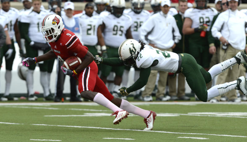 Louisville's DeVante Parker, left, outruns the grasp of South Florida's George Baker during action of their NCAA colege football game Saturday Oct. 20, 2012 in Louisville, Ky.  Louisville defeated USF 27-25. (AP Photo/Timothy D. Easley)