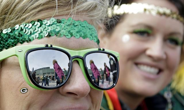 Lambeau Field is reflected in the glasses of fan Trina Blaschko before an NFL football game between the Green Bay Packers and the Cleveland Browns Sunday, Oct. 20, 2013, in Green Bay, Wis. (AP Photo/Tom Lynn)