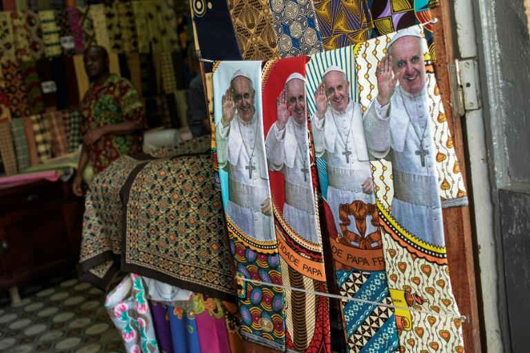 Mozambicans have been splurging on pope-related regalia (AFP Photo/GIANLUIGI GUERCIA)