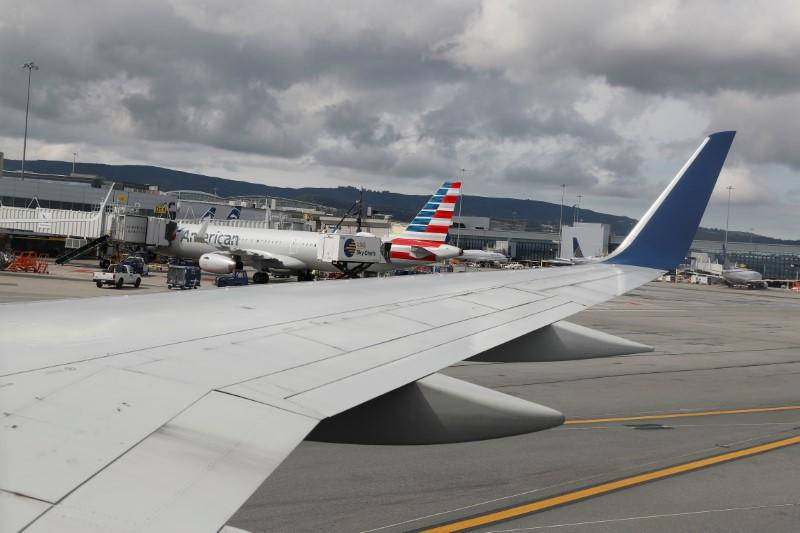 Planes are parked at gates at San Francisco International Airport