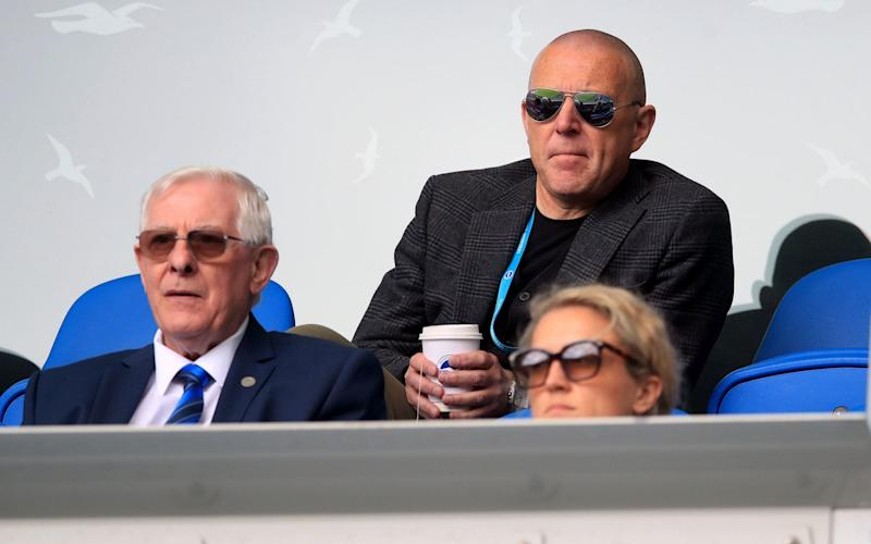 Brighton and Hove Albion's Chief Executive and Deputy Chairman Paul Barber (back) in the stands during the pre-season friendly at the AMEX Stadium in Brighton where up to 2500 fans have been allowed in to watch the match after the Government announced a further batch of sporting events that will be used to pilot the safe return of spectators - Adam Davy/PA