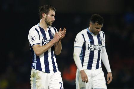 Britain Football Soccer - Watford v West Bromwich Albion - Premier League - Vicarage Road - 4/4/17 West Bromwich Albion's Craig Dawson applauds fans after the match Action Images via Reuters / Andrew Couldridge Livepic