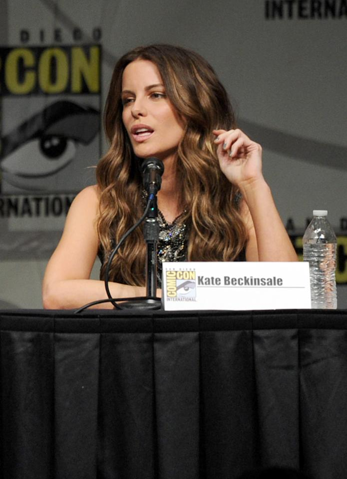 """SAN DIEGO, CA - JULY 13:  Actress Kate Beckinsale speaks during Sony's """"Total Recall"""" panel during Comic-Con International 2012 at San Diego Convention Center on July 13, 2012 in San Diego, California.  (Photo by Kevin Winter/Getty Images)"""