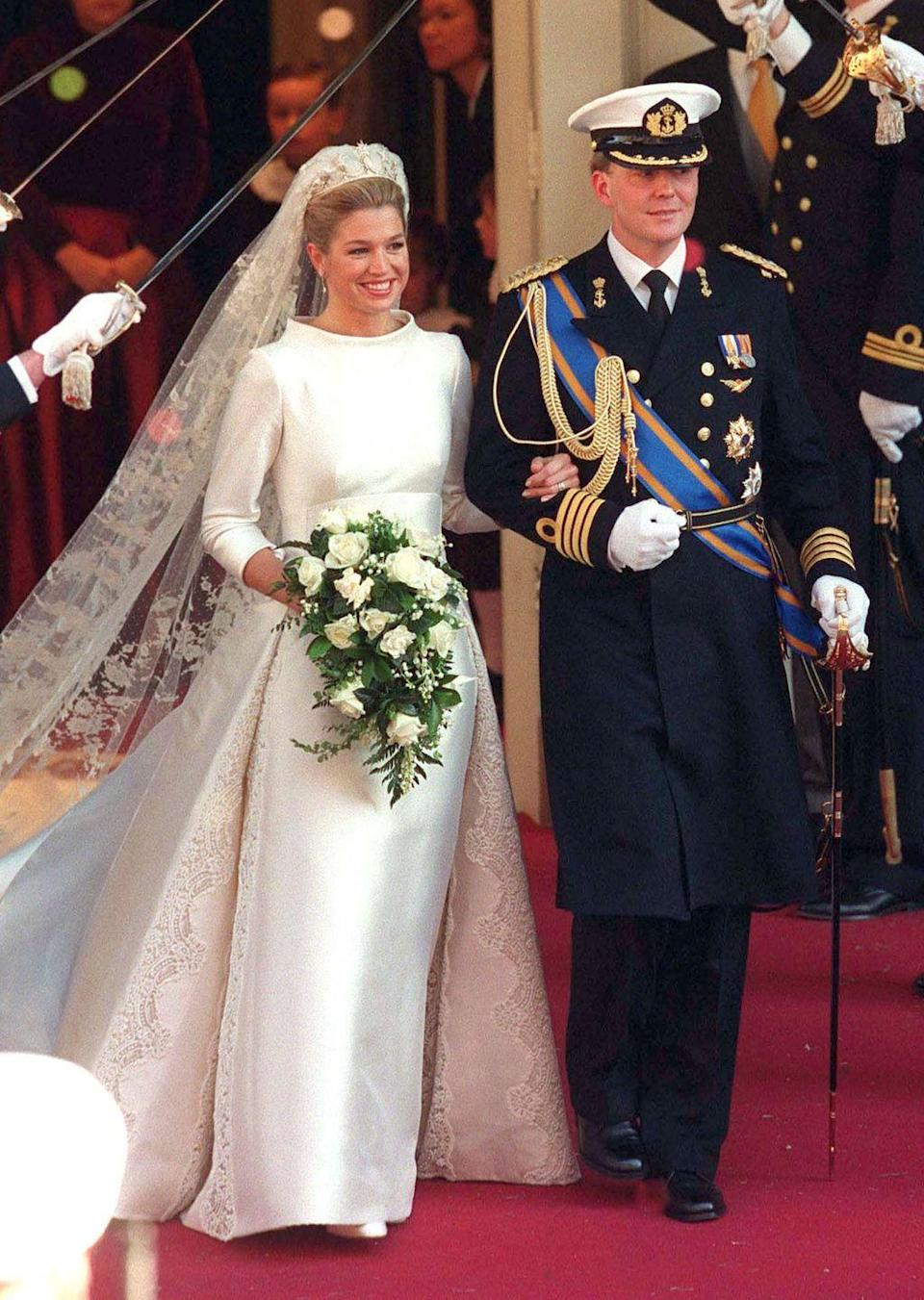 <p>Queen Máxima wore a long-sleeve sheath dress with a high neckline and a lace veil when she married King Willem-Alexander.</p>