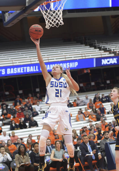 South Dakota State's Tylee Irwin (21) goes for a layup against Quinnipiac during of a first-round game in the NCAA womens college basketball tournament in Syracuse, N.Y., Saturday, March 23, 2019. South Dakota State won 76-65. (AP Photo/Heather Ainsworth)