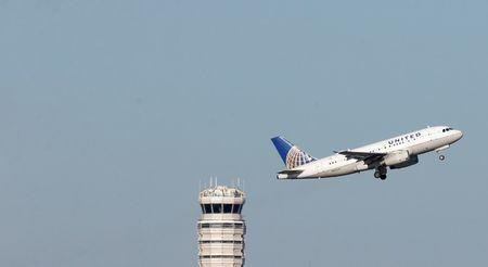 A United Airlines jet takes off from Washington National Airport in Washington