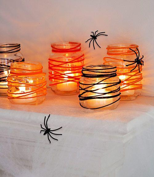 <p>Recycle used baby-food jars as spidery votives with this easy DIY. For each candle holder, dip 48 inches of yarn into a one-part Elmer's glue, two-part water solution. Squeeze out excess; wrap strand around the jar from the top down. When dry, add a LED tealight. </p>