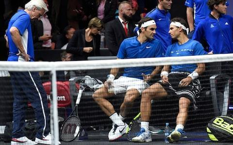 <span>Roger Federer and Rafa Nadal talk tactics</span> <span>Credit: AFP </span>