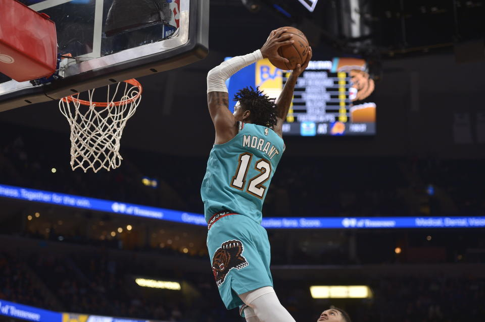 Memphis Grizzlies guard Ja Morant (12) goes up for a dunk in the second half of an NBA basketball game against the Golden State Warriors Sunday, Jan. 12, 2020, in Memphis, Tenn. (AP Photo/Brandon Dill)