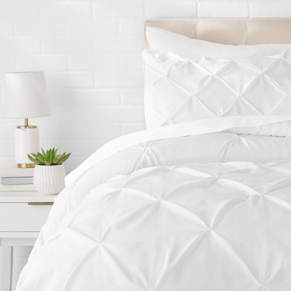 """<h2>Pinch Pleat Down-Alternative Comforter Bedding Set</h2><br><br><strong>AmazonBasics</strong> Pinch Pleat Down-Alternative Comforter Bedding Set, $, available at <a href=""""https://amzn.to/33UBBEb"""" rel=""""nofollow noopener"""" target=""""_blank"""" data-ylk=""""slk:Amazon"""" class=""""link rapid-noclick-resp"""">Amazon</a>"""