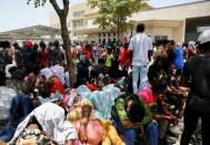 Haitians gather outside the U.S. Embassy after the assassination of President Jovenel Moise, in Port-au-Prince