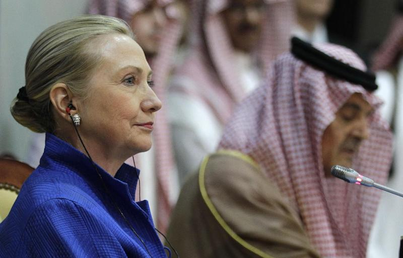 """US Secretary of State Hillary Rodham Clinton, left, listens to Saudi Foreign Minister Prince Saudi al-Faisal, right, during a press conference after her meeting with the foreign ministers of the Gulf Cooperation Council """"GCC"""" in Riyadh, Saudi Arabia, Saturday, March 31, 2012. The Obama administration is seeking to advance talks among Saudi Arabia and its neighbors on a missile defense system against Iran, while slowing any plans among Arab Gulf states to intervene militarily in Syria. (AP Photo/Hassan Ammar)"""