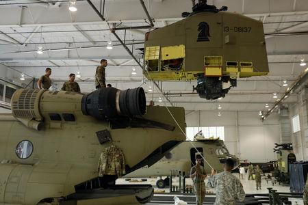 Soldiers from the 1st Armored Division, Combat Aviation Brigade, work to disassemble a CH-47 Chinook helicopter to ship to Puerto Rico in order to aid in recovery efforts following Hurricane Maria at Fort Bliss in El Paso, Texas, U.S., September 29, 2017. Picture taken September 29, 2017. REUTERS/Lucas Jackson