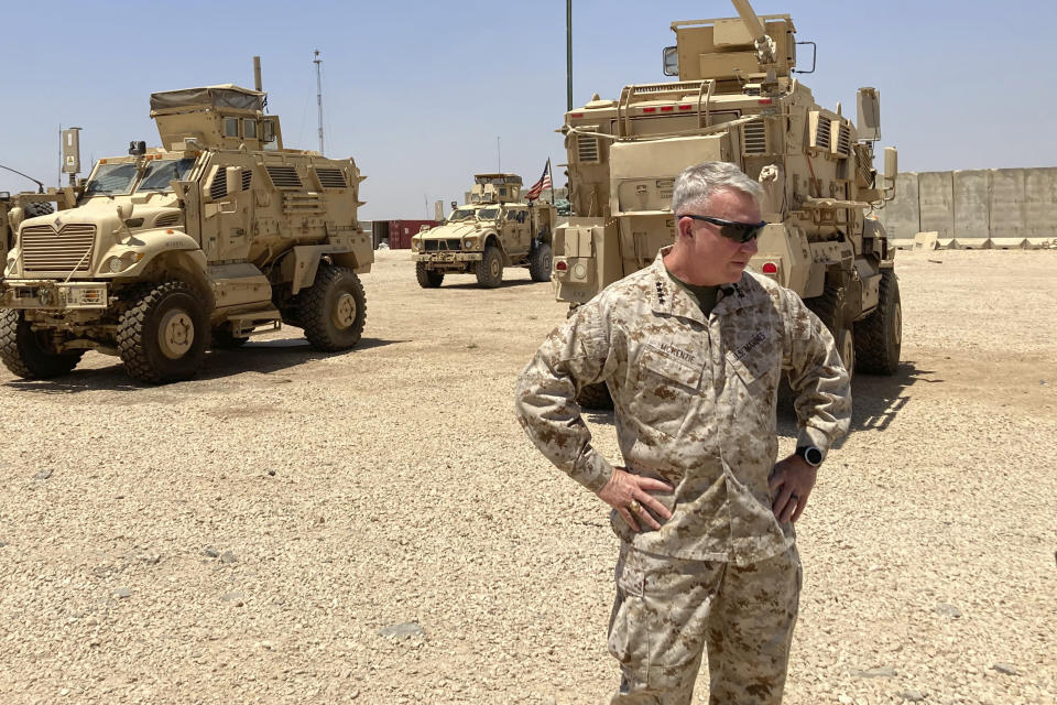 Marine Gen. Frank McKenzie, the top U.S. commander for the Middle East, speaks to the media after arriving in Syria to meet with U.S. and allied commanders and troops, Friday, May 21, 2021. The Iraqi government for the first time is expected to bring home about 100 Iraqi families from a sprawling camp in Syria next week, a move that U.S. officials see as a hopeful sign in the long-frustrated effort to repatriate thousands from the camp, known as a breeding ground for young insurgents. On an unannounced visit to Syria, McKenzie expressed optimism that the transfer from the al-Hol camp will happen. (AP Photo/Lolita C. Baldor)