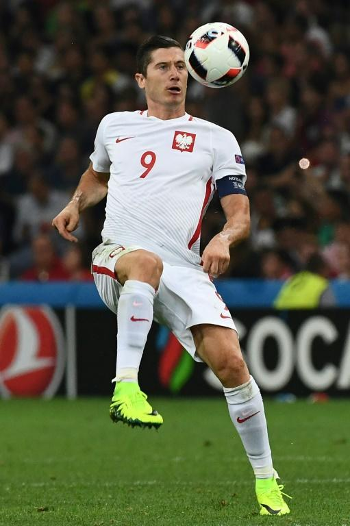 (FILES) In this file photo taken on June 30, 2016, Poland's forward Robert Lewandowski controls the ball during the Euro 2016 quarter-final football match between Poland and Portugal at the Stade Velodrome in Marseille
