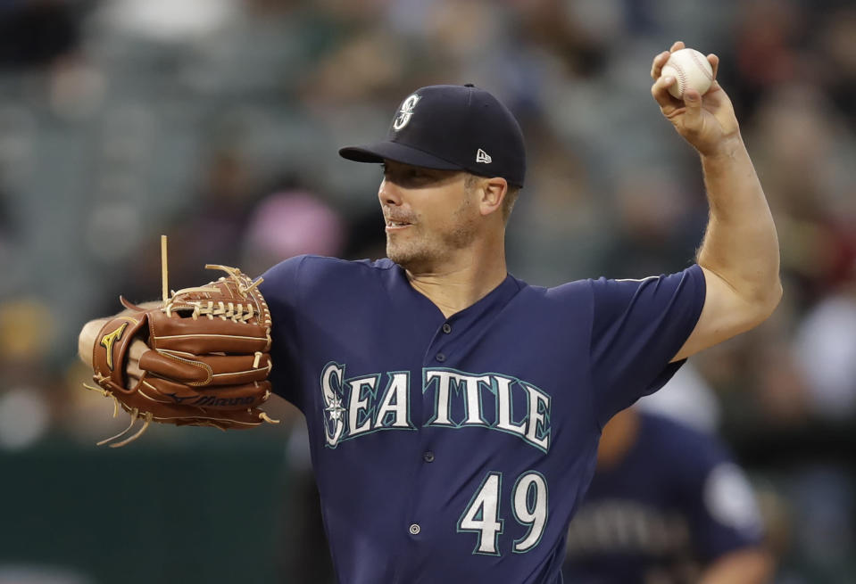 Seattle Mariners pitcher Wade LeBlanc works against the Oakland Athletics in the third inning of a baseball game Saturday, June 15, 2019, in Oakland, Calif. (AP Photo/Ben Margot)