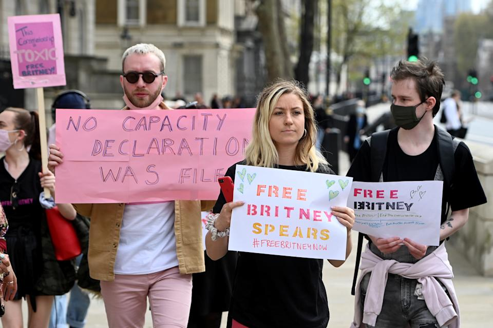 LONDON, ENGLAND - APRIL 27: Supporters of the singer Britney Spears walk down Whitehall during a #FreeBritney on April 27, 2021 in London, England. Spears was placed in a conservatorship managed by her father, Jamie Spears, and an attorney, which controls her assets and business dealings, following her involuntary hospitalization for mental care in 2008. (Photo by Kate Green/Getty Images)