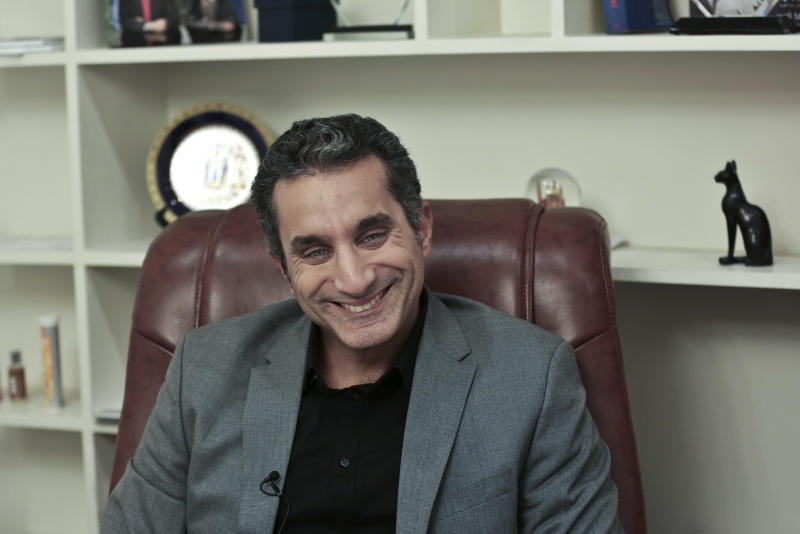 Egyptian satirist Bassem Youssef laughs during an interview with The Associated Press at his studio in downtown Cairo, Egypt, Wednesday, Jan. 8, 2014. Youssef, often compared to U.S. comedian Jon Stewart, says his team will bring back its popular television show poking fun at politics in a country still beset by turmoil following a July military coup. However, he acknowledged the challenges facing him and others in Egypt now in an interview with The Associated Press. (AP Photo/Nariman El-Mofty)
