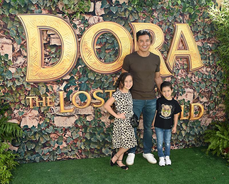 "LOS ANGELES, CA - JULY 28: Dominic Lopez, Mario Lopez, and Gia Francesca Lopez arrive at the LA Premiere Of Paramount Pictures' ""Dora And The Lost City Of Gold"" at Regal Cinemas L.A. Live on July 28, 2019 in Los Angeles, California. (Photo by Gregg DeGuire/FilmMagic)"