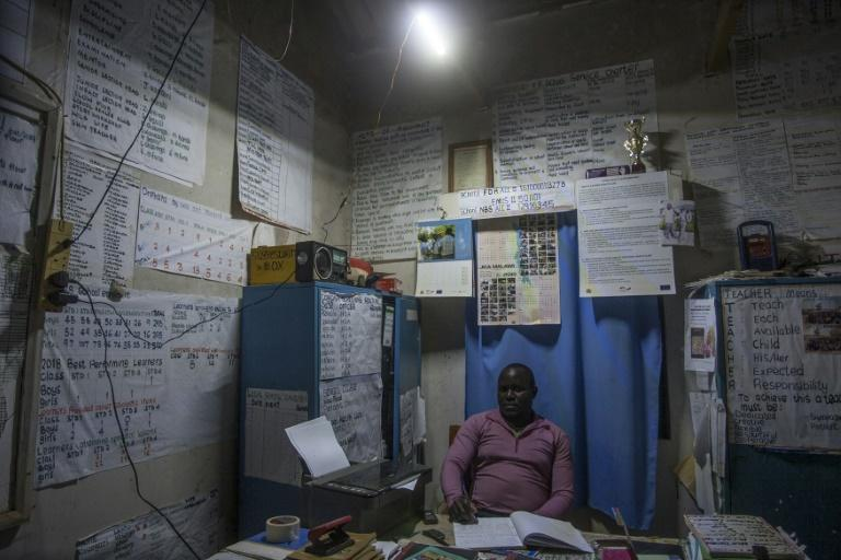Fiat lux: Thanks to Nkosi's gadget, a primary school now has electric light (AFP/AMOS GUMULIRA)