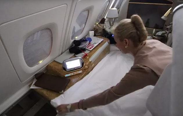 Casey attempts to make up his own bed, before a flight attendant insists on doing it for him. Image: Youtube/CaseyNeistat