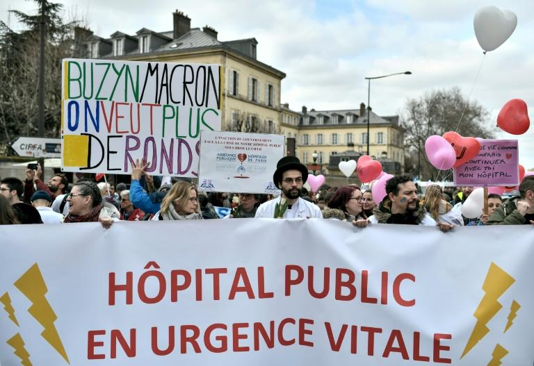 """Healthcare workers dub public hospitals """"a life-threatening emergency"""" and say """"Buzyn, Macron, we want more money"""" in a February protest -- Macron's candidate Agnes Buzyn says Paris' condition has """"deteriorated"""" recently"""