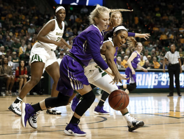 Abilene Christian guard Kamryn Mraz, front, and Baylor guard Chloe Jackson (24) chase after a loose ball in the first half of a first-round game in the NCAA women's college basketball tournament in Waco, Texas, Saturday March 23, 2019. (AP Photo/Tony Gutierrez)