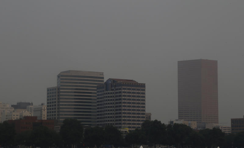 The downtown skyline is visible through hazy smoke from wildfires in Portland, Ore., Tuesday, Sept. 5, 2017. The dozens of fires burning across the Western United States and Canada have blanketed the air with choking smoke from Oregon to Colorado, where health officials issued an air quality advisory alert. (AP Photo/Don Ryan)