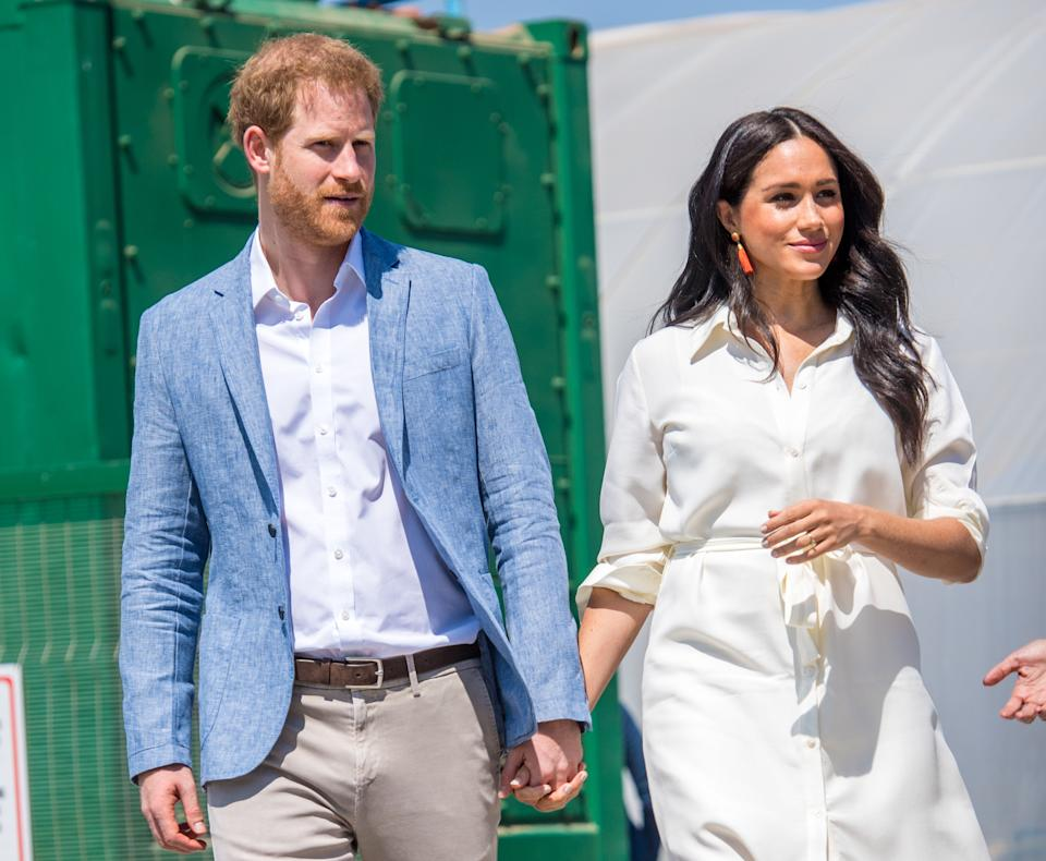 Prince Harry and Meghan, Duke and Duchess of Sussex during a visit to a township to learn about Youth Employment Services (YES), which aims to tackle the critical issue of youth unemployment in South Africa by creating one million new work opportunities in the next three years. (Photo by DPPA/Sipa USA)