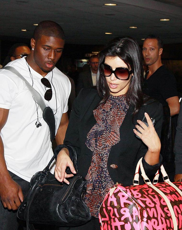 """RadarOnline.com reports that even though Kim Kardashian and Reggie Bush are secretly reuniting, the reality star still didn't invite him to her big 30th birthday bash in Las Vegas. The website says """"as much as she would want Reggie to share in her birthday celebration,"""" Kardashian isn't ready for all """"the attention it would bring."""" For the real reason behind the snub, see what a close friend explains to <a href=""""http://www.gossipcop.com/kim-kardashian-30th-thirtieth-birthday-party-bash-las-vegas-reggie-bush/"""" target=""""new"""">Gossip Cop</a>. O'Neill/White/<a href=""""http://www.infdaily.com"""" target=""""new"""">INFDaily.com</a> - January 28, 2009"""