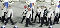 <p>Team USA arrived at the Torino games in snug red, white, and blue hats, polished parkas, and simple ski pants. </p>