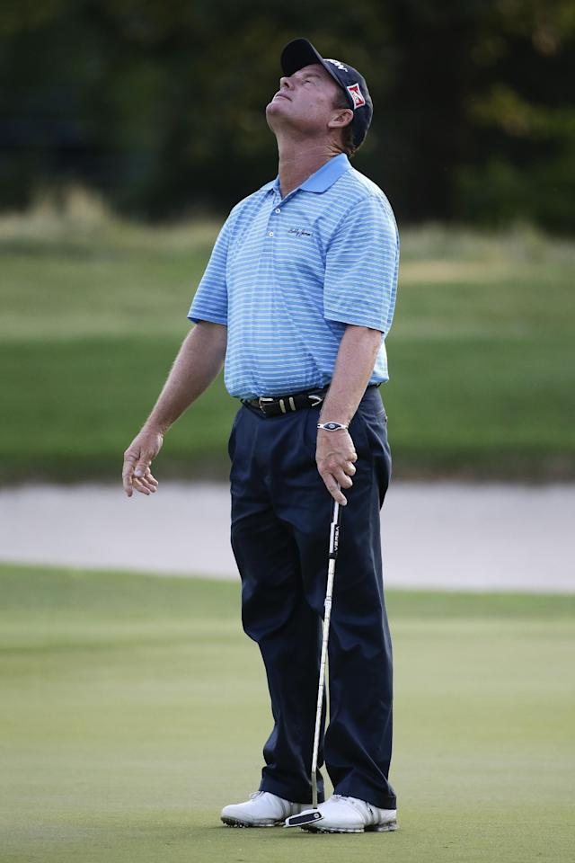 Joe Durant reacts to missing a par putt on the 6th green during the first round of the St. Jude Classic golf tournament Thursday, June 5, 2014, in Memphis, Tenn. Durant shot a bogey on the hole. (AP Photo/Mark Humphrey)