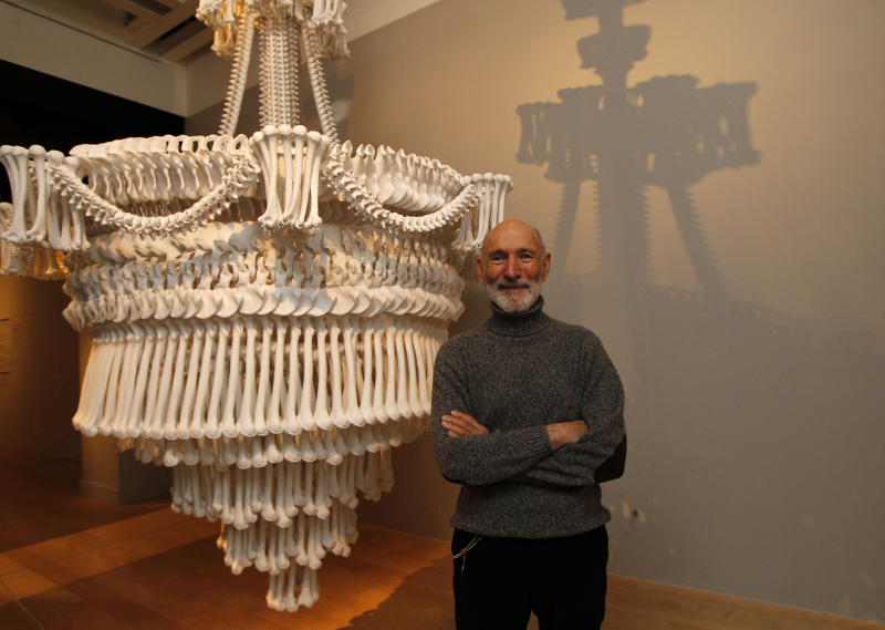 Collector Richard Harris poses with one of his collection of installation 'In the Eyes of Others' by British artist Jodie Carey on display at an exhibition 'Death : The Richard Harris Collection' at the Wellcome Collection gallery in London, Wednesday, Nov. 14, 2012. (AP Photo/Sang Tan)
