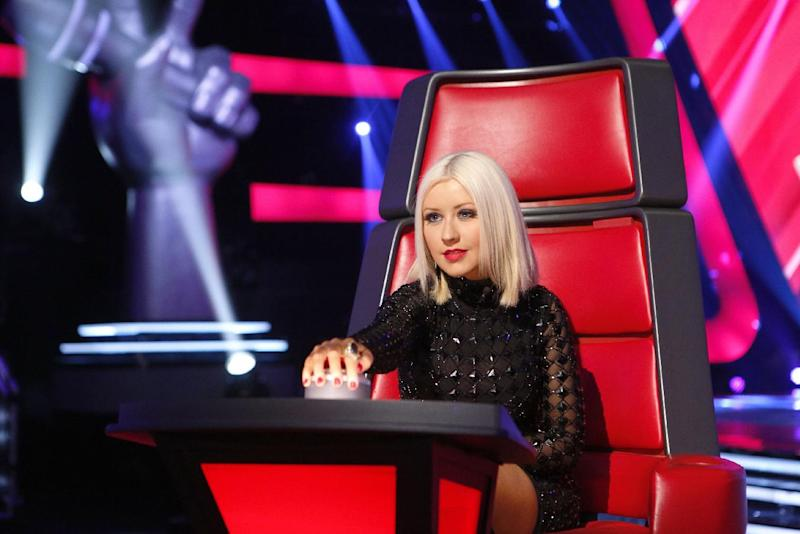 """This undated publicity photo provided by NBC shows Christina Aguilera during the """"Blind Auditions"""" for """"The Voice,"""" airing Mondays (8-10 p.m. ET) and Tuesdays (9-10 p.m. ET). Aguilera and CeeLo took time off from the show last season, and were replaced by Usher and Shakira. But they're back in their signature red chairs on Monday night, Sept. 23, 2013, when the hit talent competition premieres on NBC. (AP Photo/NBC, Trae Patton)"""