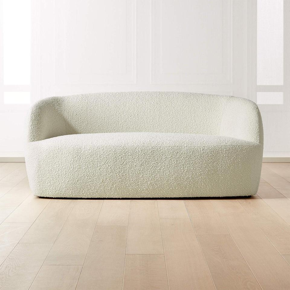 """<p>""""From the silhouette, to the choice of fabric, everything about this <span>CB2 Gwyneth Boucle Loveseat</span> ($1,099) screams elegance."""" - SJ</p>"""