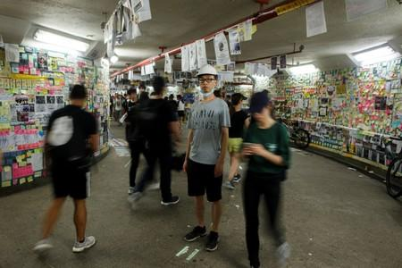 Hong Kong native and Australia resident Jason Tse poses for a portrait in a tunnel adorned with notes supporting the protests, known as Lennon Wall, in Hong Kong
