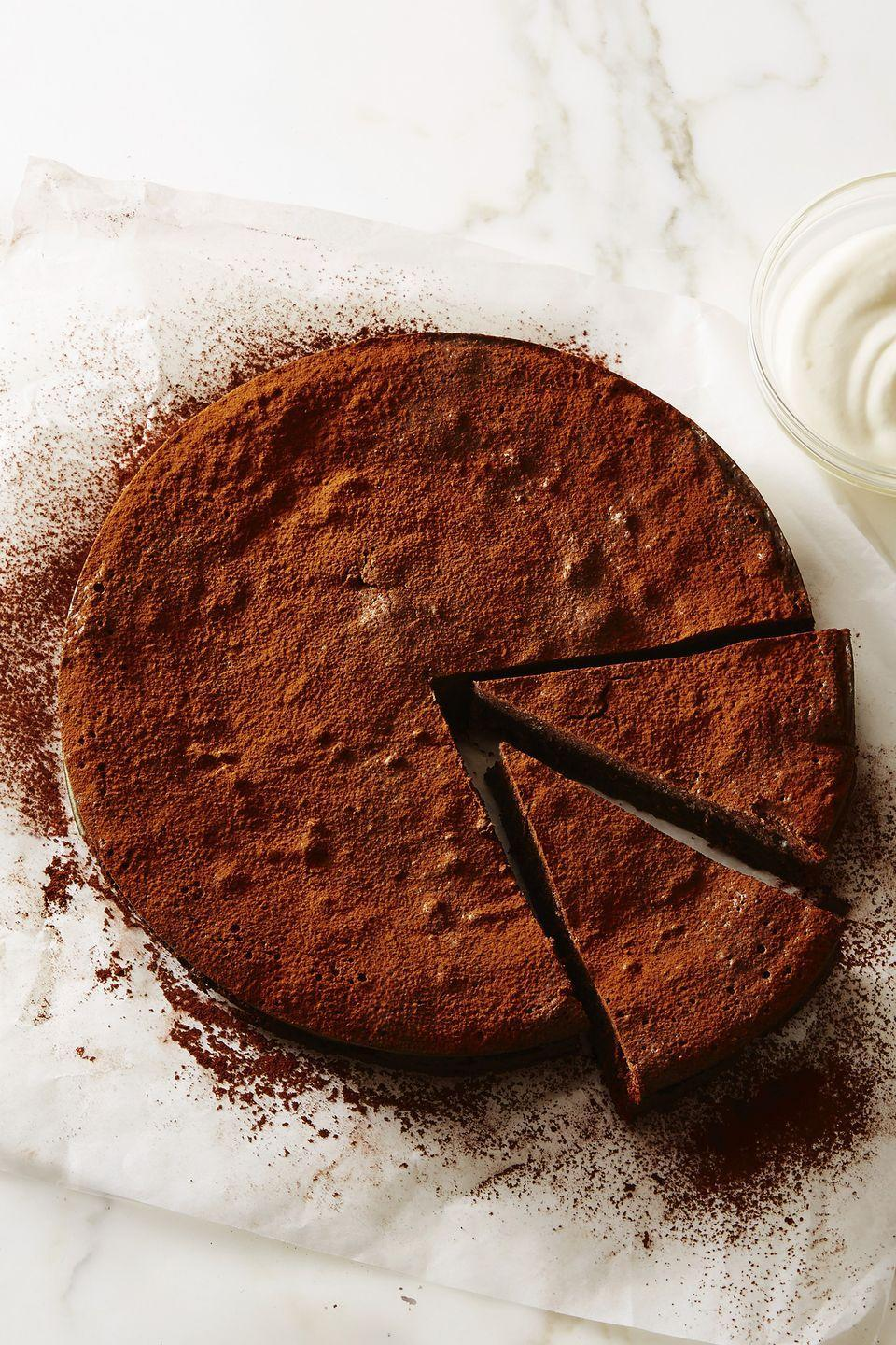 """<p>Sure, this cake may lack flour (yep, gluten-free!) but it certainly doesn't lack in flavor. </p><p><em><a href=""""https://www.goodhousekeeping.com/food-recipes/dessert/a48194/flourless-fudge-cake-recipe/"""" rel=""""nofollow noopener"""" target=""""_blank"""" data-ylk=""""slk:Get the recipe for Flourless Fudge Cake »"""" class=""""link rapid-noclick-resp"""">Get the recipe for Flourless Fudge Cake »</a></em> </p>"""