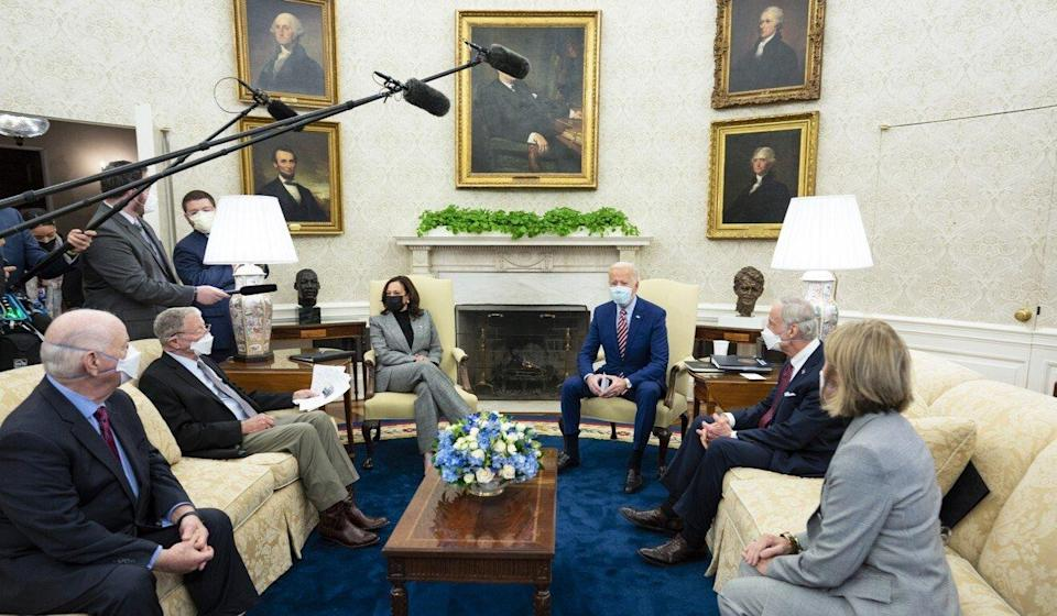 President Joe Biden (centre right) and Vice-President Kamala Harris (centre left) talk about infrastructure with a bipartisan group of four US senators in the Oval Office on Thursday. Photo: Doug Mills/The New York Times/Bloomberg