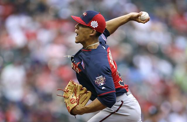World's pitcher Jose Berrios throws a pitch during the first inning of the All-Star Futures baseball game against Team United States, Sunday, July 13, 2014, in Minneapolis. (AP Photo/Jeff Roberson)