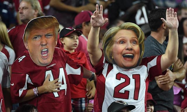 "<span class=""element-image__caption"">Arizona Cardinals fans wear masks of presidential candidates Donald Trump and Hillary Clinton in October 2016.</span> <span class=""element-image__credit"">Photograph: Norm Hall/Getty Images</span>"