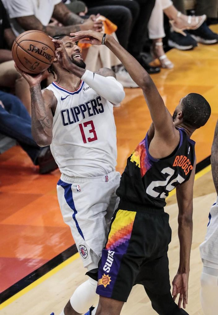 Clippers forward Paul George is pressured by Suns forward Mikal Bridges during Game 1.