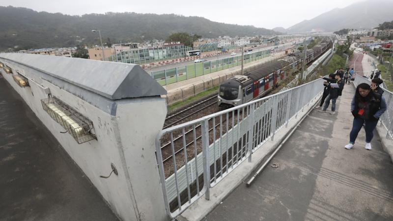 Two Hong Kong teenagers arrested after handrail hurled onto railway tracks disrupted MTR services