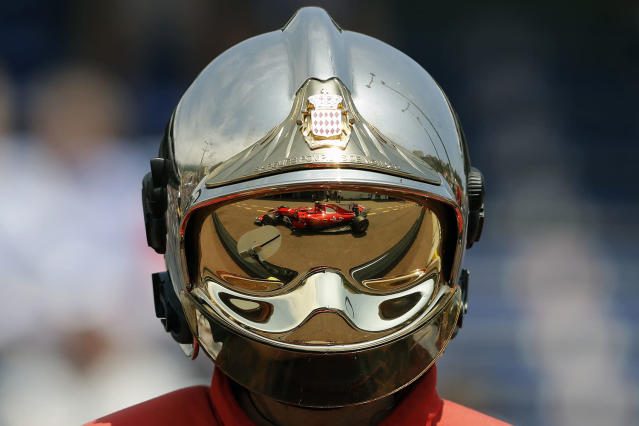 <p>Ferrari driver Kimi Raikkonen of Finland is reflected on a firefighter helmet as he steers his car during the second free practice at the Formula One Grand Prix at the Monaco racetrack in Monaco, May 25, 2017. (Photo: Frank Augstein/AP) </p>