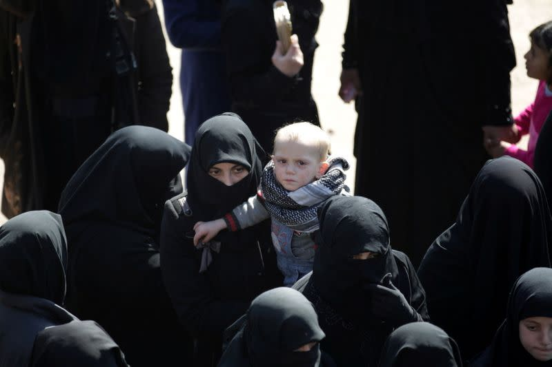 FILE PHOTO: Internally displaced refugees from al-Bab town gather to receive food aid in Ekhtreen
