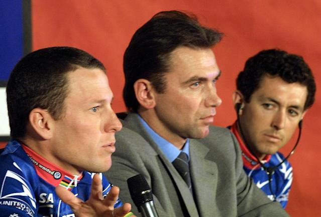 "Johan Bruyneel(C), pictured with US Postal team cyclist Lance Armstrong (L) in 2001, engaged in ""widespread, systemic doping,"" the Court of Arbitration for Sport ruled (AFP Photo/CHRISTOPHE SIMON)"